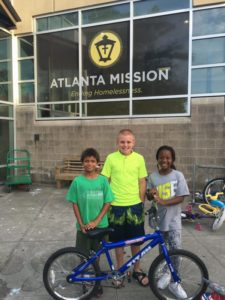 Kids at Atlanta Mission with bike