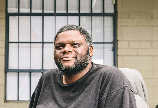 Chris, who was homeless, in his wheelchair, now at Atlanta Mission