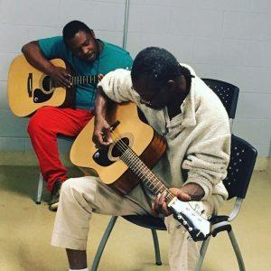 Men Practicing at the Atlanta Mission Men's Shelter Guitar Class