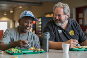volunteer-and-man-having-lunch-together