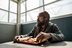 man eating lunch at Transitional Housing