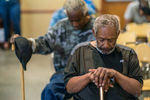 men sitting down experiencing homelessness as a veteran