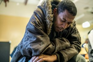 man wearing jacket facing homelessness in the winter in Atlanta