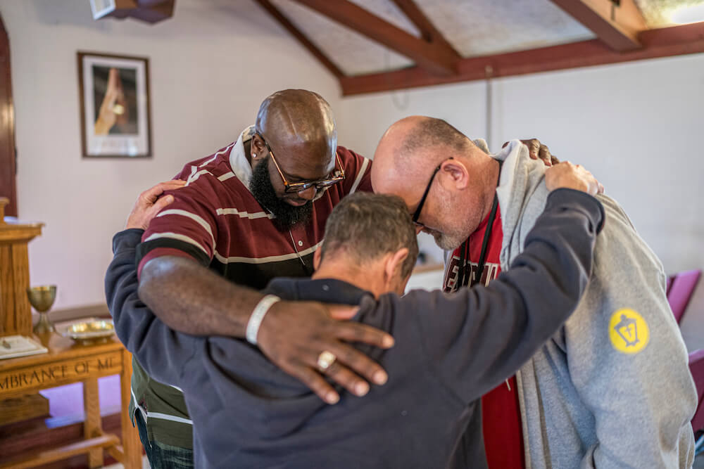 Reco and friends praying at Atlanta Mission