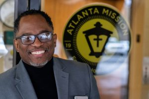 Don, Atlanta Mission staff, in front of Atlanta Mission door